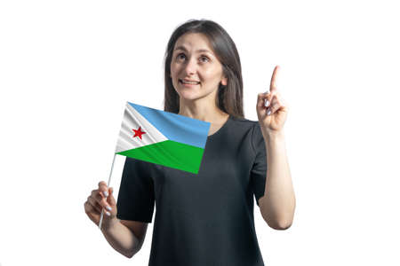Happy young white woman holding flag of Djibouti and points thumbs up isolated on a white background.