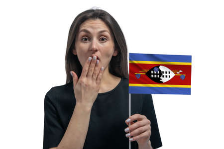 Happy young white woman holding flag of Esvatini and covers her mouth with her hand isolated on a white background.