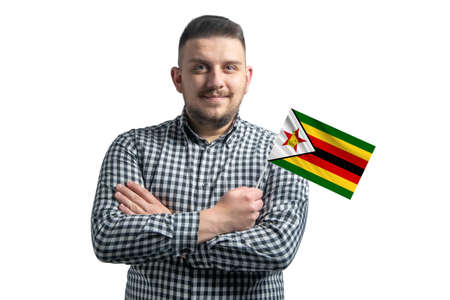 White guy holding a flag of Zimbabwe smiling confident with crossed arms isolated on a white background. 免版税图像