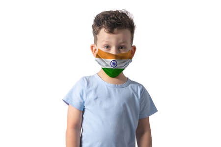 Respirator with flag of India White boy puts on medical face mask isolated on white background.