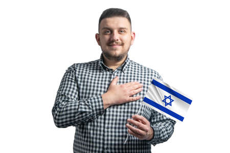 White guy holding a flag of Israel and holds his hand on his heart isolated on a white background With love to Israel.