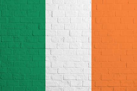 Flag of Ireland Brick wall texture of the flag of Ireland. 免版税图像