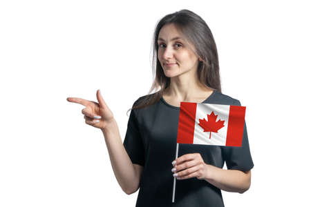 Happy young white woman holding flag Canada and points to the left isolated on a white background.