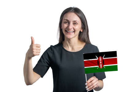 Happy young white woman holding flag of Kenya and shows the class by hand isolated on a white background.