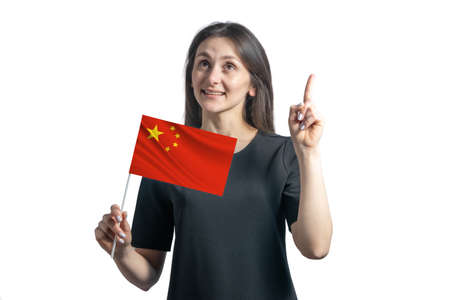 Happy young white woman holding flag of People's Republic of China and points thumbs up isolated on a white background.