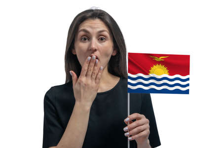 Happy young white woman holding flag of Kiribati and covers her mouth with her hand isolated on a white background.
