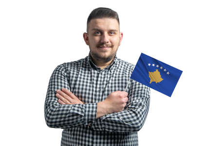 White guy holding a flag of Kosovo smiling confident with crossed arms isolated on a white background. 免版税图像