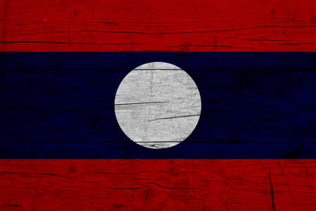 Flag of Laos Wooden texture of the flag of Laos. 免版税图像