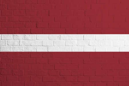 Flag of Latvia Brick wall texture of the flag of Latvia. 免版税图像