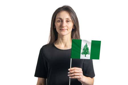 Happy young white girl holding Norfolk Island flag isolated on a white background. 写真素材