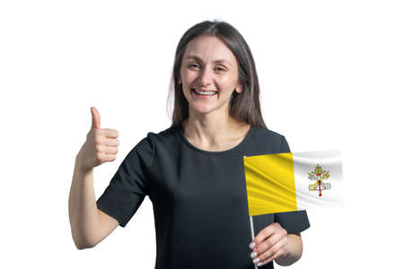 Happy young white woman holding flag of Vatican and shows the class by hand isolated on a white background.