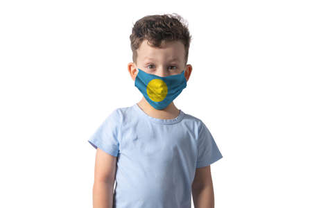 Respirator with flag of Palau. White boy puts on medical face mask isolated on white background. 写真素材