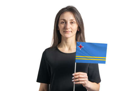 Happy young white girl holding Aruba flag isolated on a white background.
