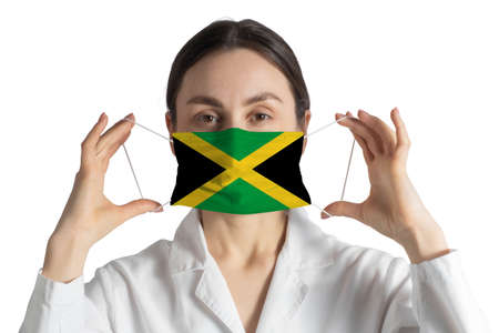 Respirator with flag of Jamaica Doctor puts on medical face mask isolated on white background.