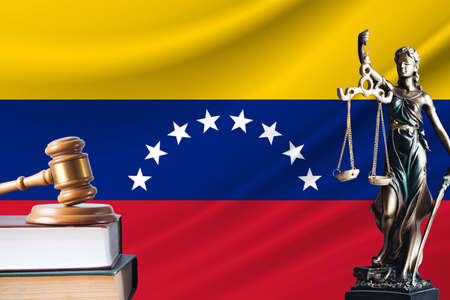 Law and justice in Venezuela. Statue of themis and the gavel of the judge against the background of the flag of Venezuela. Law and justice concept.