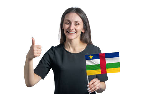 Happy young white woman holding flag of Central African Republic and shows the class by hand isolated on a white background.