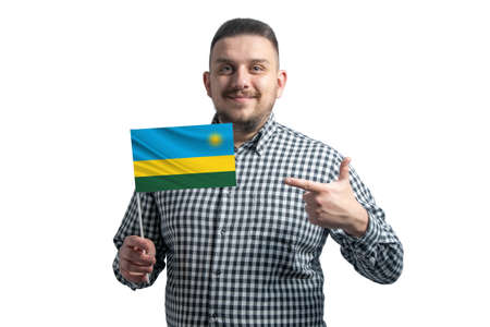 White guy holding a flag of Rwanda and points the finger of the other hand at the flag isolated on a white background. 写真素材