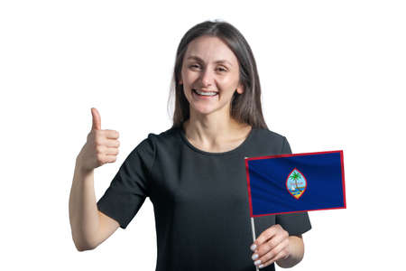 Happy young white woman holding flag of Guam and shows the class by hand isolated on a white background. 写真素材