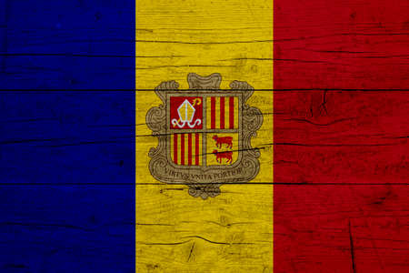 Flag of Andorra. Wooden texture of the flag of Andorra.