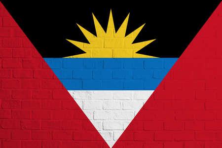 Flag of Antigua and Barbuda. Brick wall texture of the flag of Antigua and Barbuda.