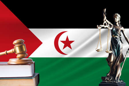 Law and justice in Western Sahara Statue of themis and the gavel of the judge against the background of the flag of Western Sahara L