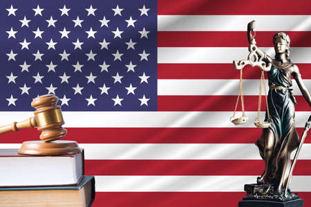 Law and justice in United States. Statue of themis and the gavel of the judge against the background of the flag of United States. Law and justice concept. 写真素材