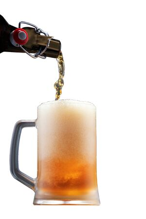 Pouring beer into a glass from the bottle, fresh foaming beer, isolated