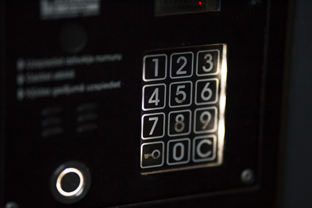 Apartment code lock black color with white backlighting. The numbers are also backlit. Imagens