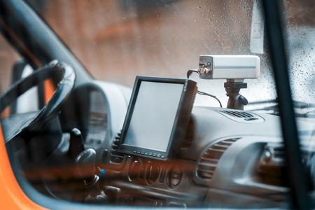 Auto Registrar in the ambulance white. The Registrar of trade level. In a car window rain drops.