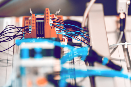 Automated Assembly line of mechanical engineering. Shallow depth of field. The background is blurred. Imagens