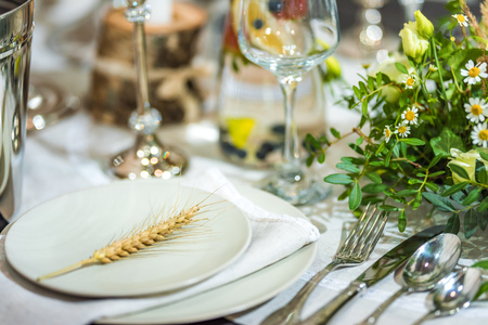 Festive dining table with flowers. Shallow depth of field. The background is blurred. Stock Photo