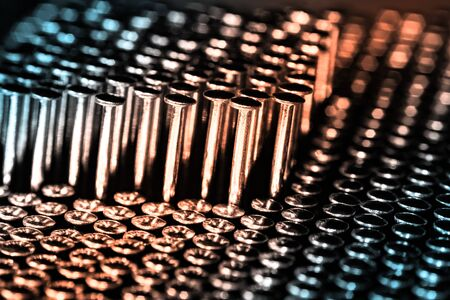 Lots of shiny little studs on a dark background arranged tightly together. Shallow depth of field. 版權商用圖片