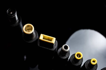 Several electro connectors on a black background shot in macro mode. Visible metal connectors of connectors. Zdjęcie Seryjne