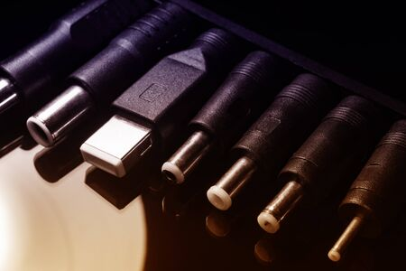 Several electro connectors on a black background shot in macro mode. Visible metal connectors of connectors.