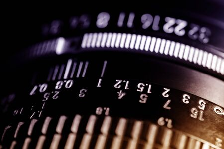 Scale of the photo lens. The black lens is made of metal and plastic. Shallow depth of field.