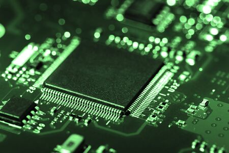 A close-up microchip with many electrical components placed on the Board. The background is blurred. Reklamní fotografie