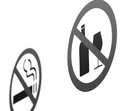 The no Smoking sign was photographed at an angle. The background is uniform. The edges of the sign are blurred. Stock Photo