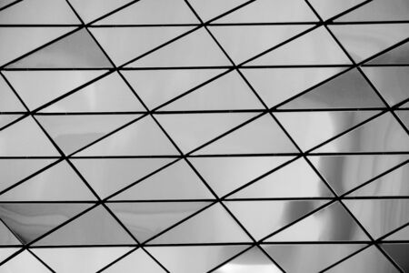 A metal wall made of many triangles. Triangles with sharp corners and gradient transitions. Stock Photo