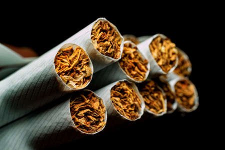 A pack of white cigarettes photographed close-up