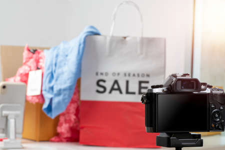A camera that can connect applications to offer products to customers is set up with the product to be taken. The background is product and the box is blurred. Stock fotó