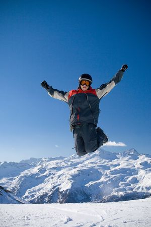 The happy guy in the mountains under the blue sky photo