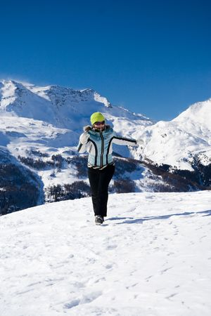 The beautiful happy running girl On a background of mountains Stock Photo - 2538057