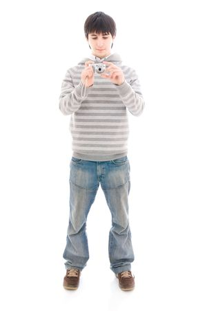 snapping fingers: The young guy with the camera isolated on a white background Stock Photo