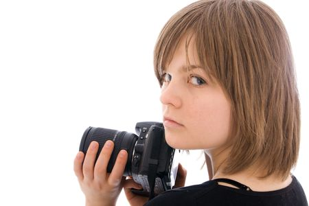 The young beautiful girl with the camera isolated on a white background photo