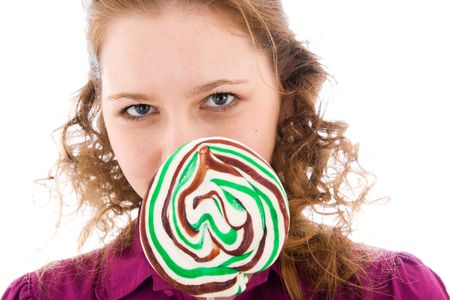 The girl with a sugar candy isolated on a white background photo
