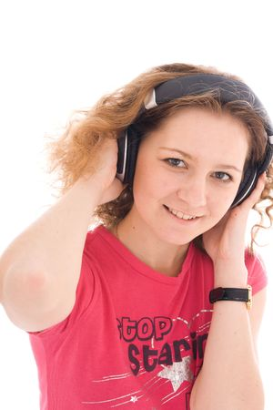 The young girl with a headphones isolated on a white background photo