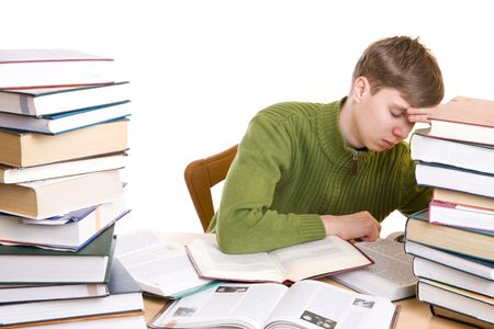 The sleeping student with books isolated on a white background photo