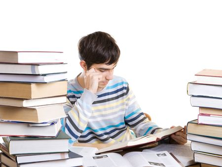 The young student with books isolated on a white background photo