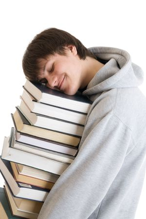The young student with a pile of books isolated on a white background photo