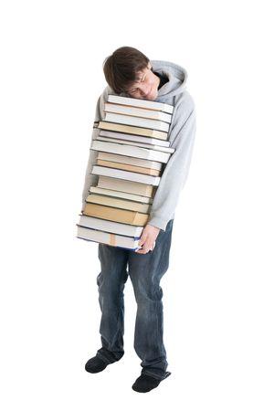 pile of books: Il giovane studente, con una pila di libri isolato su uno sfondo bianco
